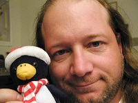 roland-jay-fake-man-16-people-man-and-penguin-2-public-domain-photos-dot-com-200w